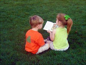children-sharing-book