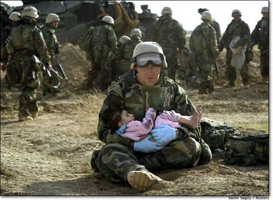 iraq-soldierHoldingIraqiChild