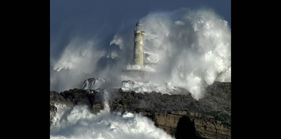 Mouro Lighthouse, Spain is built on a solid rock. These ferocious waves exceed the height of 37.5 meters (123 feet)!