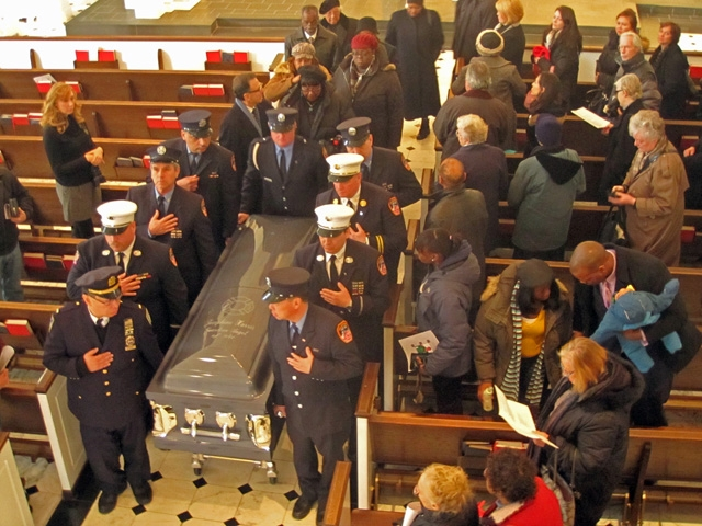 The men of Ladder 6 carry Josephine Harris one last time. -photographer unidentified