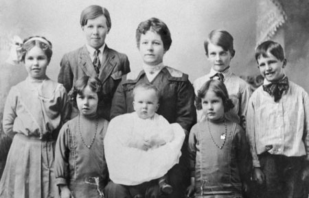 Sarah Benson with her 7 children (and 1 on the way) at the time of her husband's mission call to England.