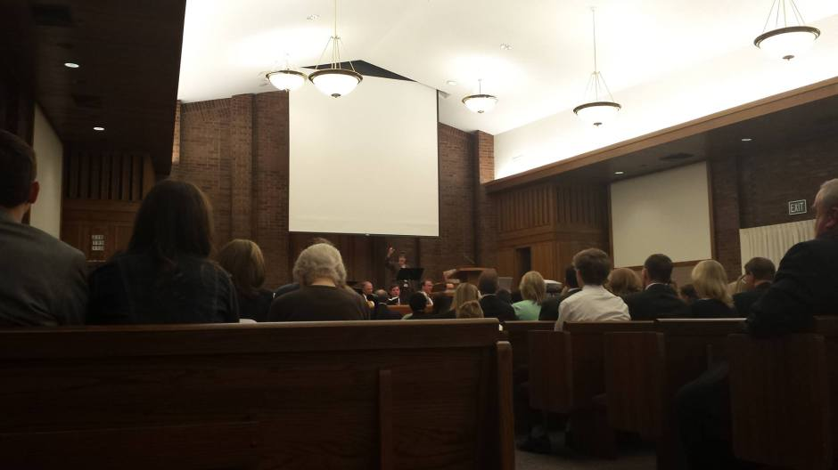 The congregation sings a hymn as we prepare for the realignment. (The screen is to project a map of the boundary changes)