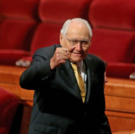Elder L. Tom Perry giving a victorious fist pump to the crowd, April 2013