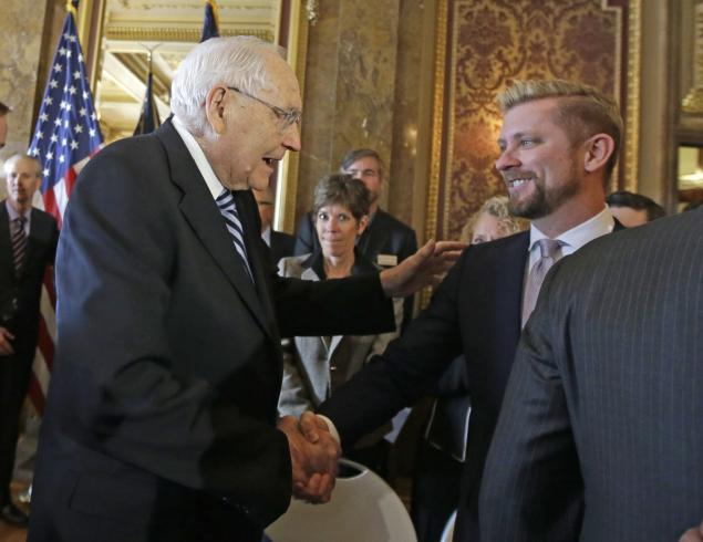 Wednesday, March 4, 2015: Elder L. Tom Perry, left, of the Church of Jesus Christ of Latter-day Saints Quorum of the Twelve Apostles shakes hands with Equality Utah executive director Troy Williams after Utah lawmakers introduced a landmark anti-discrimination bill that protects LGBT individuals while also carving out protections for the Boy Scouts of America and religious groups during a news conference at the Utah State Capitol in Salt Lake City. (AP Photo/Rick Bowmer)