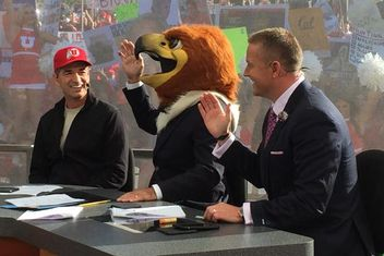 ESPN anchor Coach Corsco picks UTAH for the win and dons the Swoop Mascot head - flanked by John Stockton (left) and Kirk Herbstreit (right)