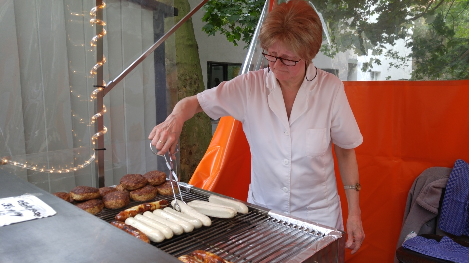 This cute Germany lady was all business with her brats, and they were cooked to perfection!