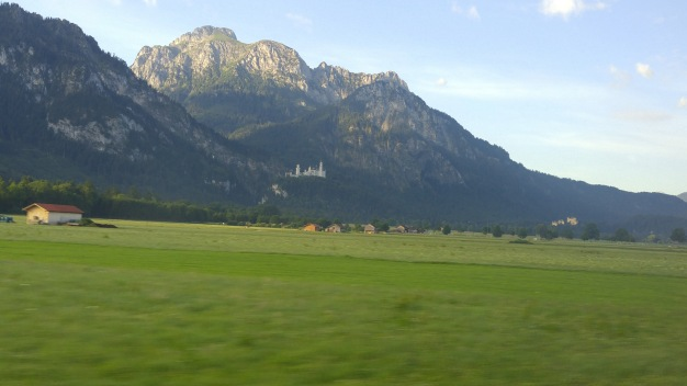 Neuschwanstein seen from the distance through my bus window.